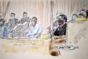 Salah Abdeslam, le principal suspect des attentats du 13 novembre 2015, et les co-accusés Mohamed Amri et Mohamed Abrini au premier jour du procès, le mercredi 8 septembre 2021.