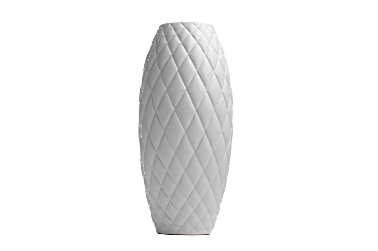 Ce vase joue les illusionnistes avec son habillage matelassé. Vase Quited, effet matelassé, Bo Concept, 79 €