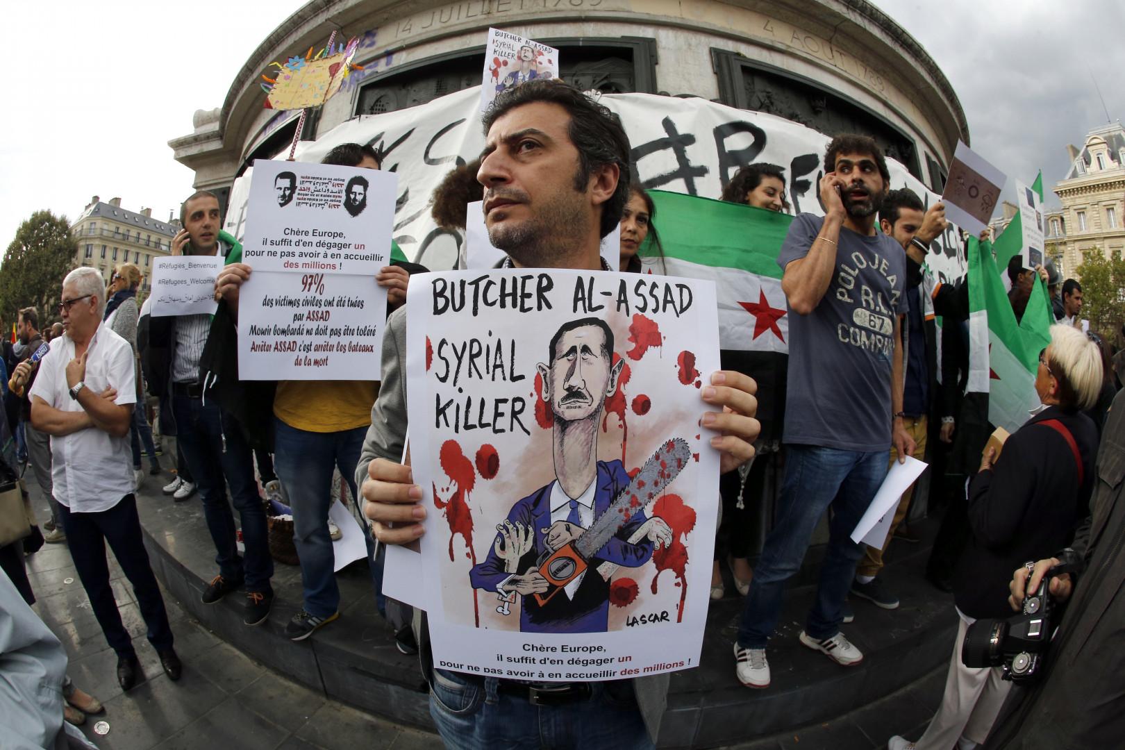 """""""Bashar al-Assad, Syrial Killer"""", peut-on lire sur cette pancarte"""