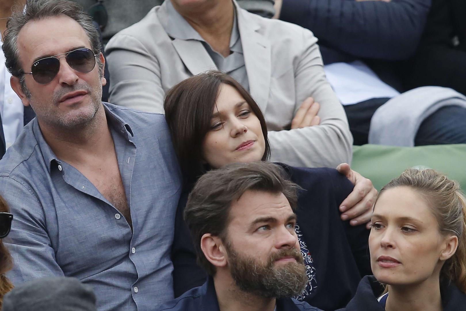 Jean Dujardin et sa compagne, l'ancienne patineuse Nathalie Pechalat, étaient au côté de Clovis Cornillac pour assister à la finale Djokovic-Murray le 5 juin.
