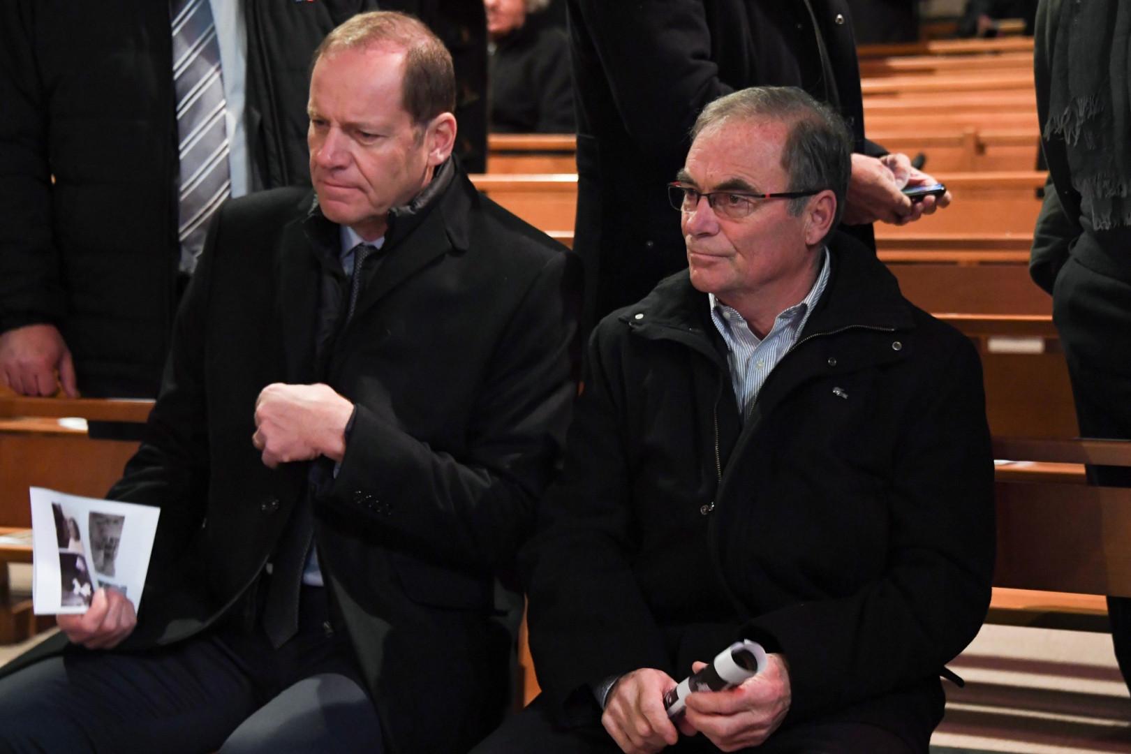 Le patron du Tour de France  Christian Prudhomme  et l'ancien vainqueur de la Grande Boucle Bernard Hinault aux obsèques de Raymond Poulidor, le 19 novembre