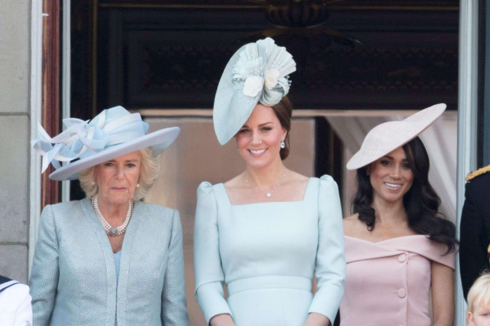 Camilla la duchesse de Cornouailles, Kate la duchesse de Cambridge et Meghan la duchesse de Sussex au balcon du palais de Buckingham, le 9 juin 2018