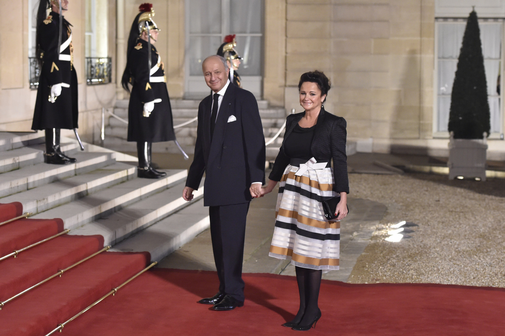 Laurent Fabius et sa compagne, à l'Élysée le 1er février 2016