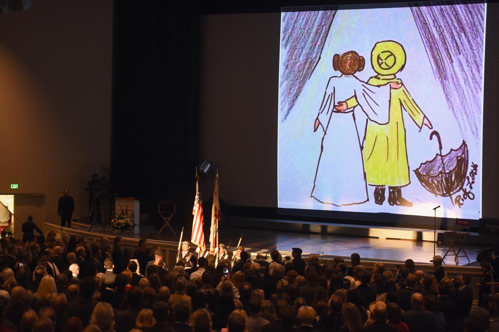 """Un dessin rappelant """"Star Wars"""" pour Carrie Fisher et """"Chantons sous la pluie"""" pour Debbie Reynolds"""