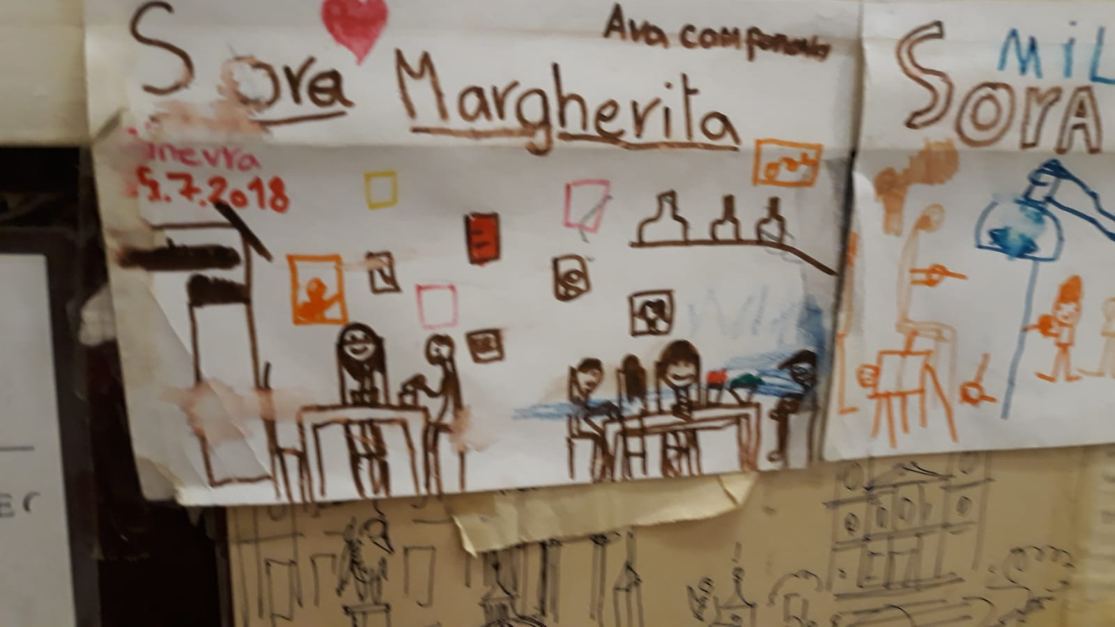 Un des petits mots et dessins collés sur le mur du resto dans le ghetto Sora Margherita