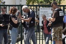 Des forces de police en charge de l'enquête et de la sécurisation d'Air Products ciblé par un attentat en Isère le 26 juin 2015