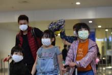 Des personnes masquées à cause du coronavirus