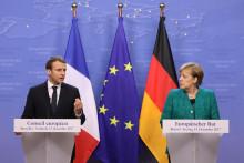 Emmanuel Macron et Angela Merkel lors de leur conférence de presse commune durant le sommet de l'Union européenne