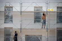Des travailleurs sur un chantier (illustration)