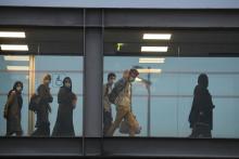 (Illustration) Des passagers, qui ont fui l'Afghanistan, débarquent à l'aéroport de Roissy Charles-de-Gaulle, le 18 août 2021.