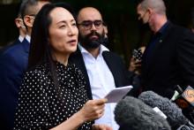 La directrice financière de Huawei, Meng Wanzhou à la sortie de la Cour suprême son audience d'extradition le 24 septembre