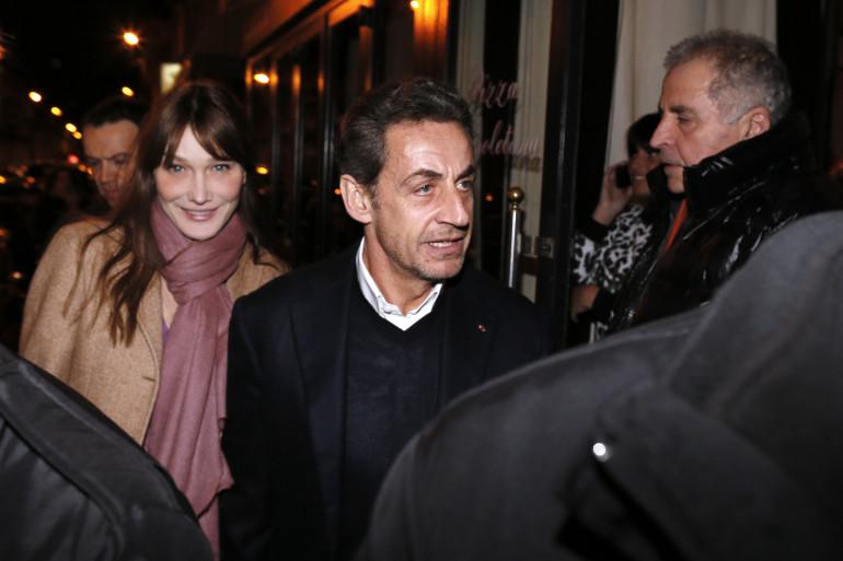 L'ancien couple présidentiel, se rendant dans un restaurant pour célébrer les 58 ans de Nicolas Sarkozy, le 28 janvier 2013 à Paris.