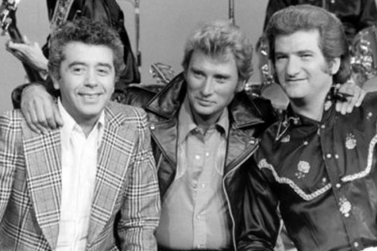 Henri Leproux à gauche aux côtés de Johnny Hallyday et Eddy Mitchell.