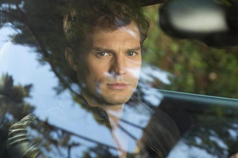"""Jamie Dornan incarne Christian Grey dans l'adaptation cinématographique de """"50 Nuances de Grey""""."""
