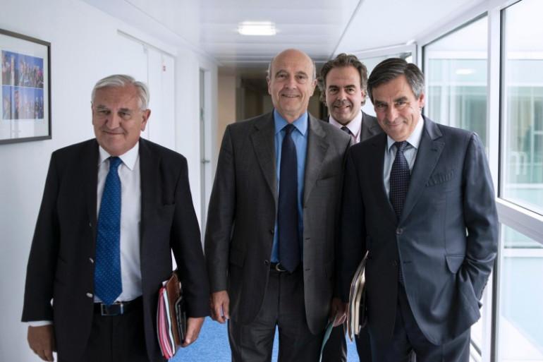 Le triumvirat à la tête du l'UMP, composé de Jean-Pierre Raffarin, Alain Juppé et François Fillon, le 17 juin 2014 dans les locaux du parti