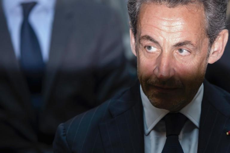 """Un enquête judiciaire a été ouverte pour """"violation du secret de l'instruction"""" en marge de l'affaire de trafic d'influence qui vise Nicolas Sarkozy. Ici le 28 février 2014 à Berlin (Archives)."""