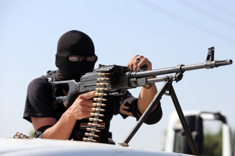 Un milicien chiite combat des jihadistes de l'État islamique en Irak et au Levant, le 12 juillet 2014 à Samarra (image d'illustration)