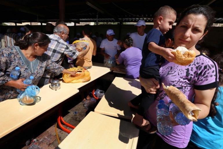 Des chrétiens d'Irak, réfugiés près d'Erbil, la capitale du Kurdistan irakien, le 12 août 2014.