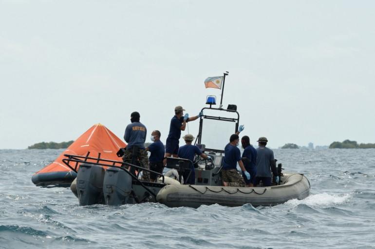 Des secouristes à la recherche de survivants après le naufrage d'un ferry en août 2013 aux Philippines (Archives).