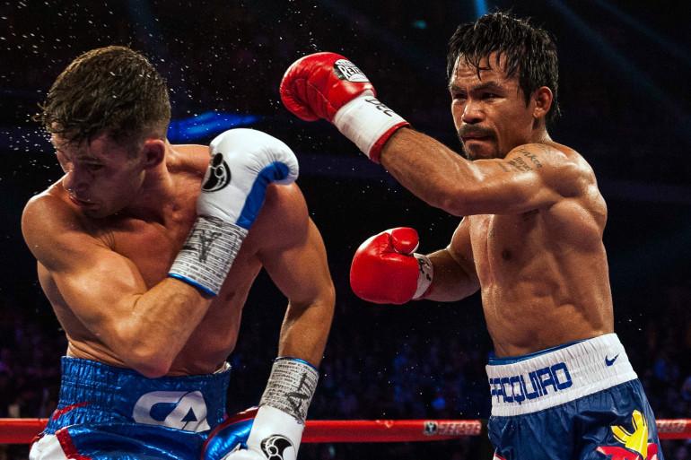 Manny Pacquiao (à droite) contre Chris Algieri, à Macao, le 22 novembre 2014. (archives)