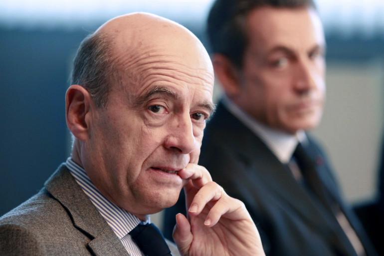 Alain Juppé et Nicolas Sarkozy le 15 novembre 2011, à Bordeaux. (archives)