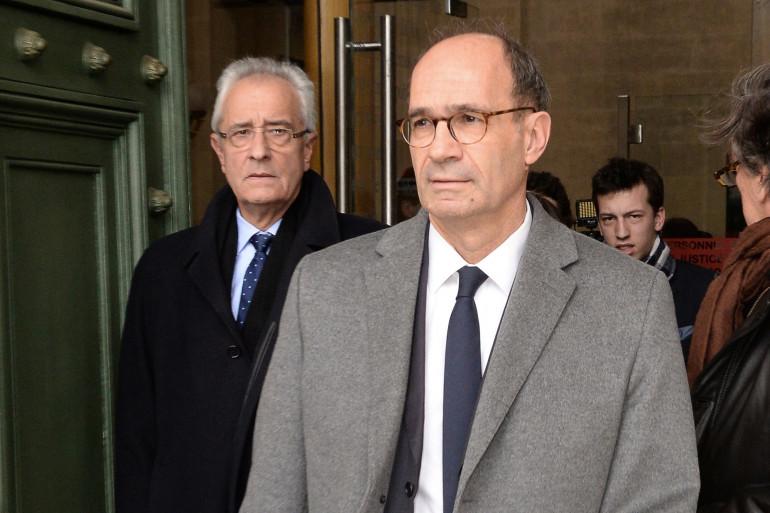 Eric Woerth et son avocat Me Jean-Yves Le Borgne quittent le tribunal de Bordeaux, le 23 février 2015.