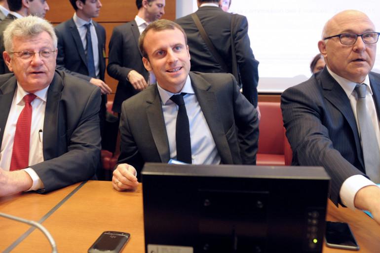 Christian Eckert, Emmanuel Macron et Michel Sapin, le 22 avril 2015 à Paris