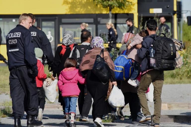 Des migrants prêts à embarquer dans des bus en Allemagne. (illustration)