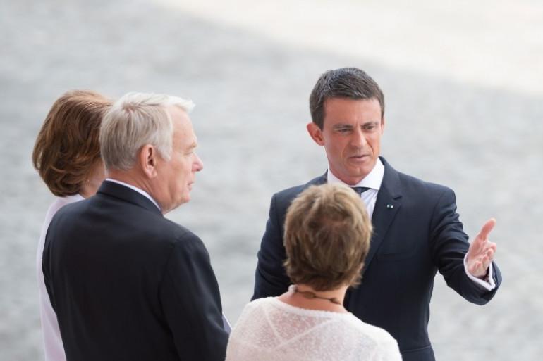 Jean-Marc Ayrault et Manuel Valls le 14 juillet 2015 à Paris