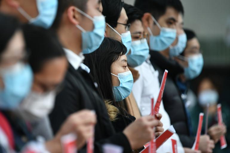 Des personnes masquées pour se protéger du coronavirus (illustration)