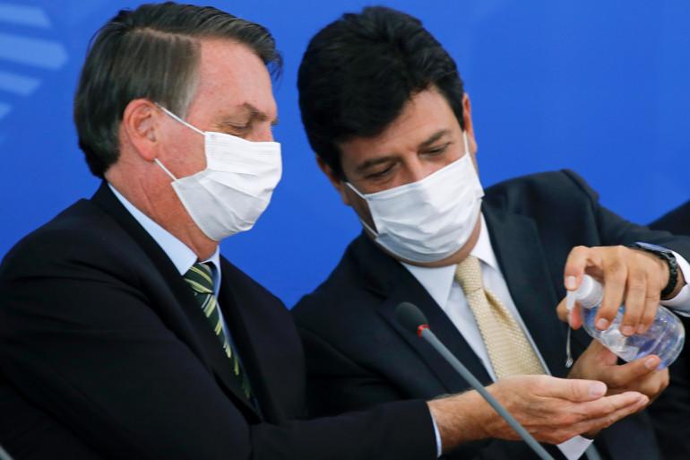 Jair Bolsonaro et Luiz Henrique Mandetta, ministre brésilien de la Santé, le 18 mars 2020 à Brasília.