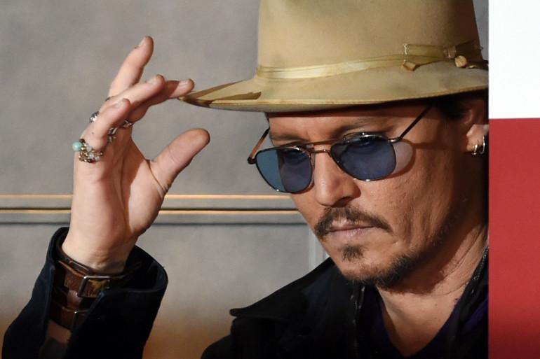 """Johnny Depp à la première japonaise du film """"Charlie Mortdecai"""", à Tokyo, le 27 janvier 2015 (archives)."""