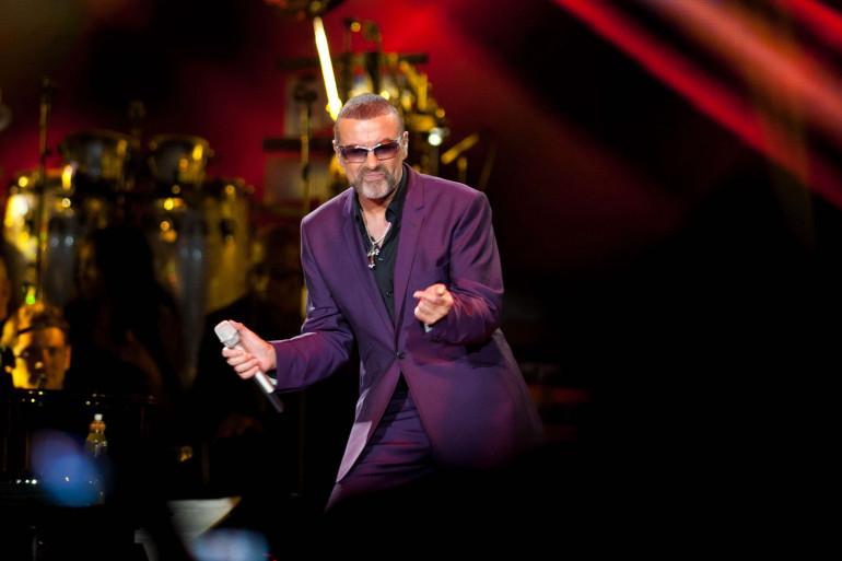 George Michael, sur la scène du LG Arena à Birmingham, le 16 septembre 2012