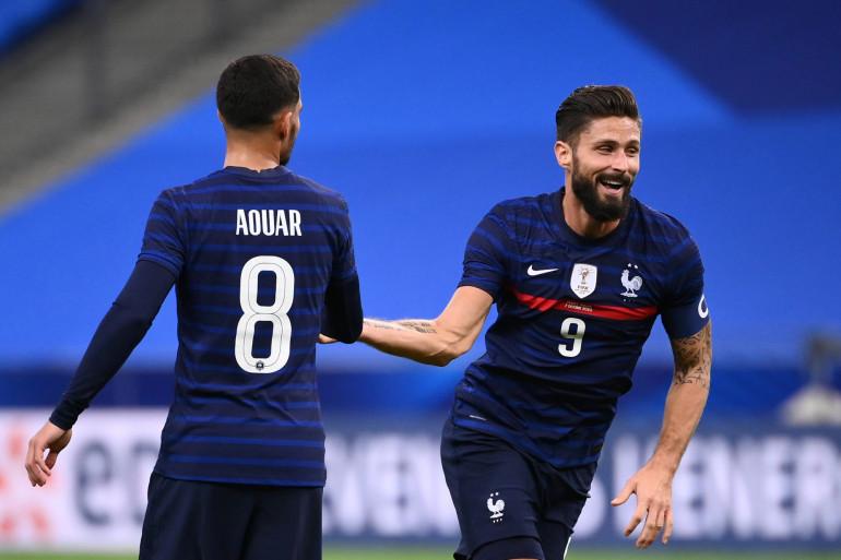 Houssem Aouar et Olivier Giroud au Stade de France le 7 octobre 2020
