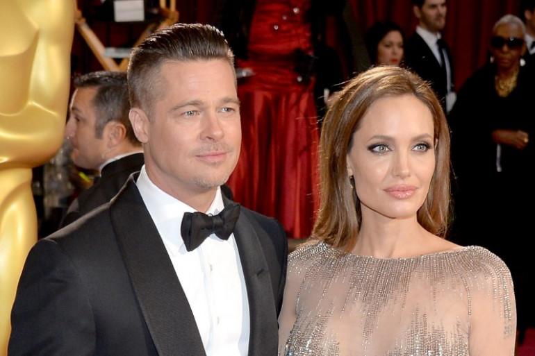 Brad Pitt et Angelina Jolie, ici aux Oscars le 2 mars 2014, vont se marier (archives)