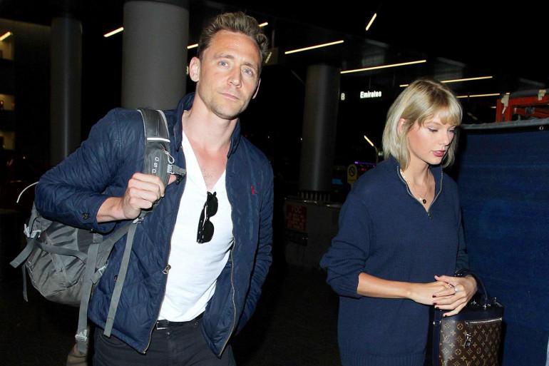 Taylor Swift et Tom Hiddleston à l'aéroport de LAX International Airport de Los Angeles le 6 juillet 2016.