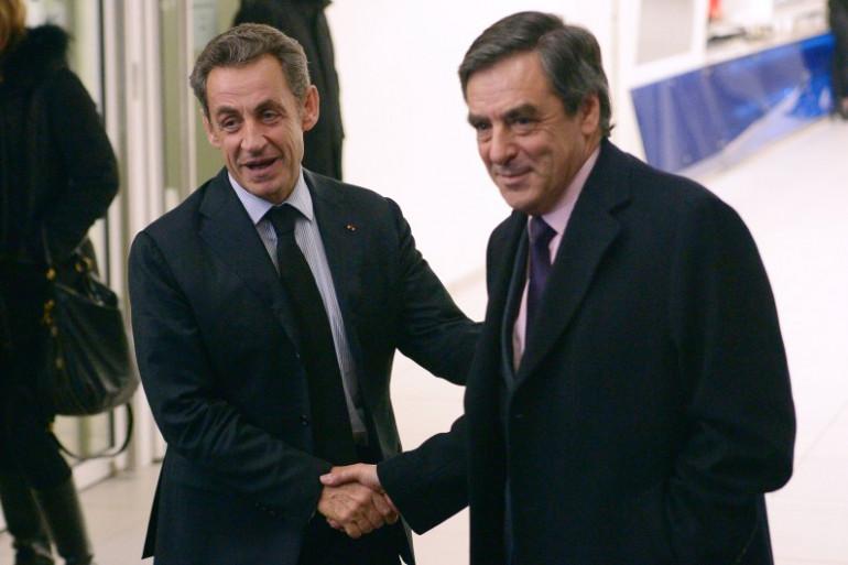 Nicolas Sarkozy et François Fillon en 2014 dans les locaux de l'ancien UMP