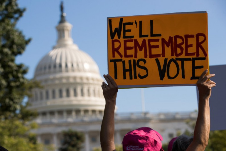 Des manifestants protestent contre l'abrogation d'Obamacare, le 26 juillet 2017, à Washington.