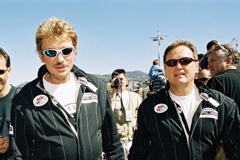 Johnny Hallyday et André Boudou au débart du Rallye Optic 2000 en Tunisie en 2001