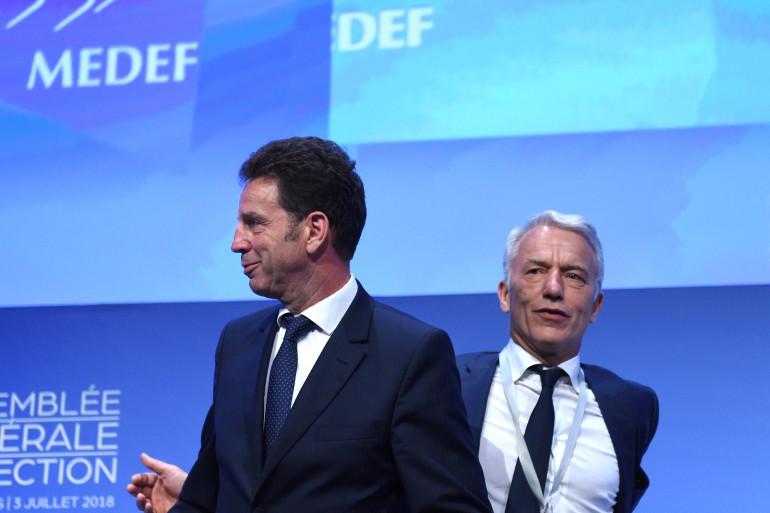 Le président du Medef Geoffroy Roux de Bezieux (gauche) et son vice-président Patrick Martin le 3 juillet 2018