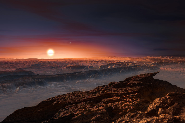 """Vue de synthèse de ce à quoi pourrait ressembler la surface de """"Proxima B"""", une des planètes jumelles de la Terre"""