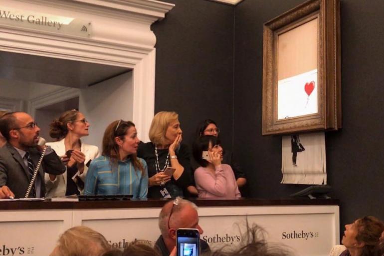 Une oeuvre de Banksy s'autodétruit devant l'assemblée, médusée, d'une vente aux enchères à Londres vendredi 5 octobre 2018