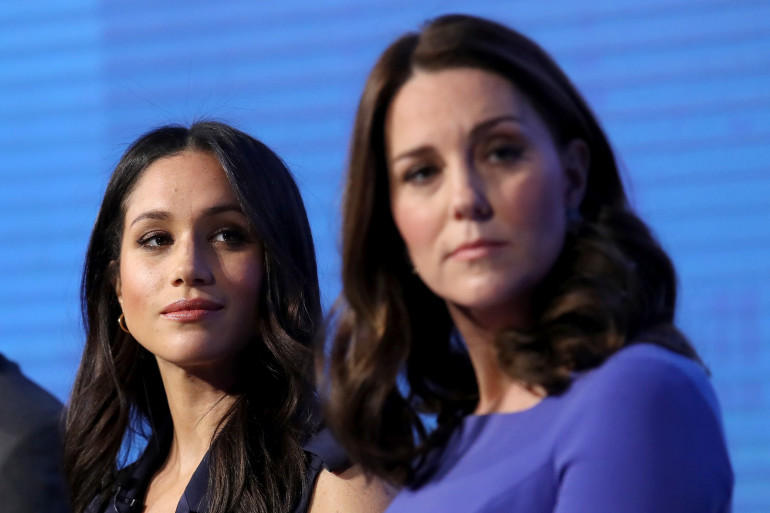 Meghan Markle (gauche) et Kate Middleton le 28 février 2018