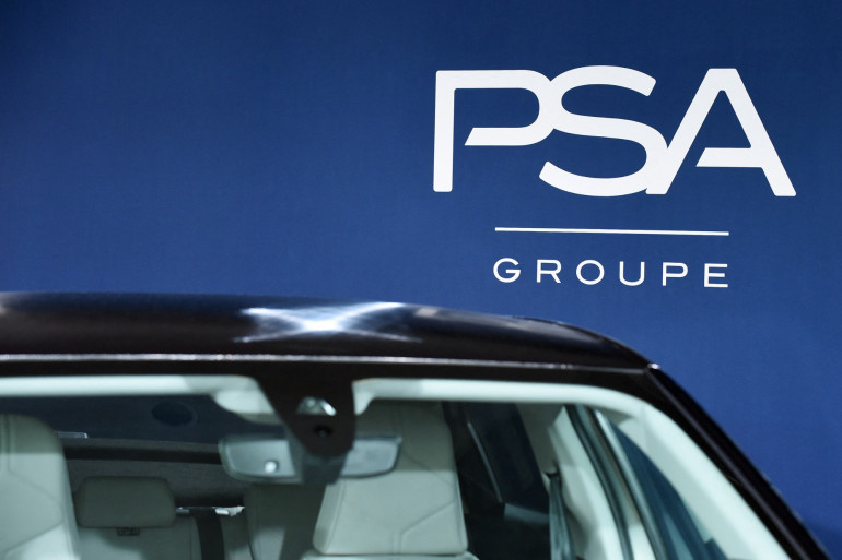 Le logo du Français automobile PSA Groupe est affiché au siège du Groupe PSA à Rueil-Malmaison le 26 février 2019. (Illustration)