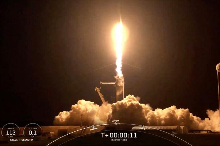 Cette capture d'écran tirée de la webdiffusion en direct de SpaceX, montre la fusée Falcon 9 de SpaceX transportant l'équipage d'Inspiration4, décollant de l'espace depuis la base Kennedy de la NASA en Floride, mercredi 15 septembre.