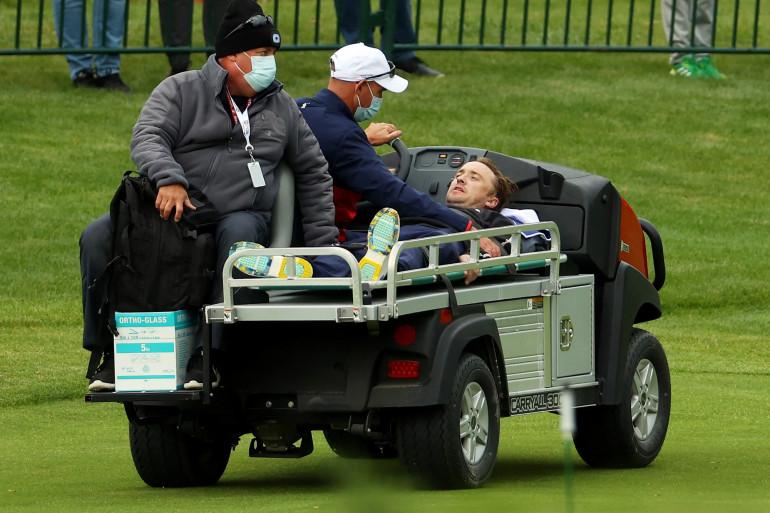 Tom Felton évacué sur une voiturette lors de la Ryder Cup.