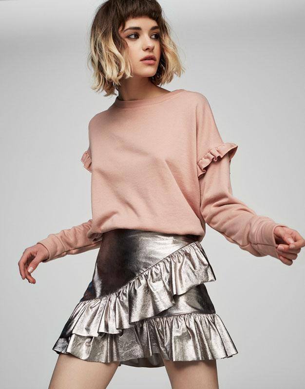 Mini jupe métallisée à volants